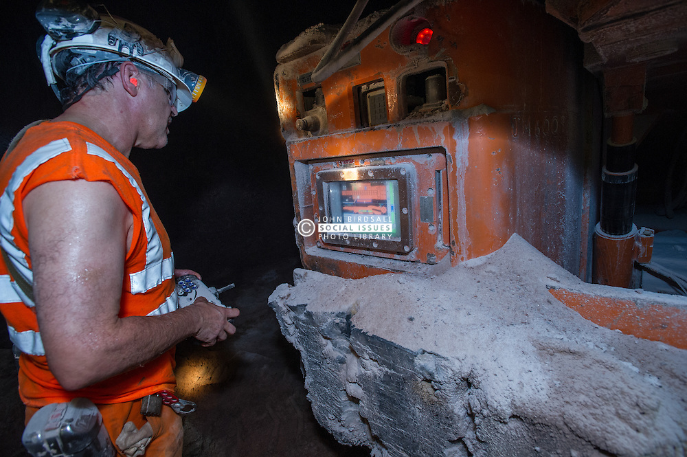 A continuous miner in Boulby Potash mine is checked for rate of production