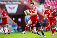 Llanelli, UK. 15 May, 2021.<br /> Scarlets right wing Tom Rogers on the attack during the Scarlets v Cardiff Blues PRO14 Rainbow Cup Rugby Match.<br /> Credit: Gruffydd Thomas/Alamy Live News