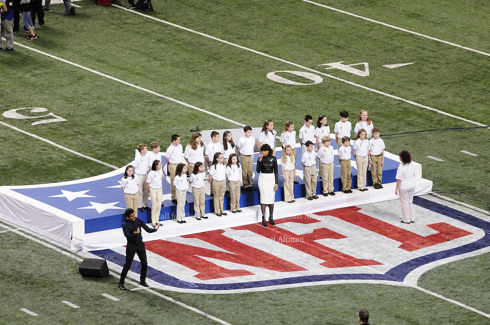 2/3/13 New Orleans LA.-NFL Alicia Keys performs the Star Spangled Banner and Jennifer Hudson sings with the Sandy Hook Elementary School Choir before the start of Super Bowl XLV11 at the Mercedes Benz Super Dome. The Francisco 49er's take on the Baltimore Ravens Sunday Feb. 3, 2013. The ravens went on to win 34-31. Photo©Suzi Altman