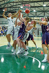 06 December 2017: Emily Farris, Rebekah Ehresman, Jordan Myroth, Maddie Merritt and Hannah Frazier all scramble for a loose ball beneath the basket during an NCAA women's basketball game between the Wheaton Thunder and the Illinois Wesleyan Titans in Shirk Center, Bloomington IL