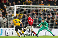 Wolverhampton Wanderers forward Diogo Jota (18) shoots and scores a goal 2-0 during the The FA Cup match between Wolverhampton Wanderers and Manchester United at Molineux, Wolverhampton, England on 16 March 2019.