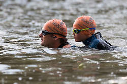 © Licensed to London News Pictures. 31/08/2018. London, UK.  Participants Wilf Pryor, aged 8 with his father take part in the Tidal River Swim in Hammersmith this evening, launching this years Thames Festival. Over 100 brave enthusiasts took part in a 30 minute swim, as they followed the tide towards Chiswich Eycot and back. Photo credit: Vickie Flores/LNP