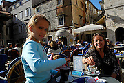 Mother and daughter (9 years old) at cafe in John Paul II Square (Trg Ivana Pavla II) on a bright, sunny autumn day. Trogir, Croatia