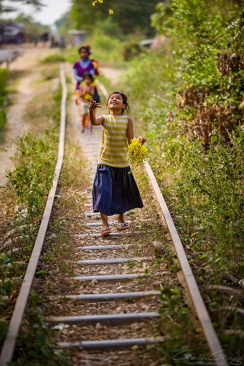 "Children play along the tracks of the now disused ""Bamboo Railway"", O Sra Lav, Battambang, Cambodia"