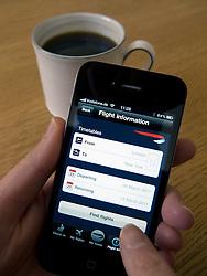 Checking passenger flight information on British Airways application on an Apple iphone 4G smart phone