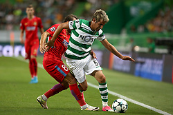 August 15, 2017 - Lisbon, Portugal - Sporting's defender Fabio Coentrao from Portugal (R ) vies with Steaua's midfielder Lucian Filip during the UEFA Champions League play-offs first leg football match between Sporting CP and FC Steaua Bucuresti at the Alvalade stadium in Lisbon, Portugal on August 15, 2017. (Credit Image: © Pedro Fiuza/NurPhoto via ZUMA Press)