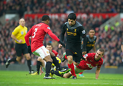 13.01.2013, Old Trafford, Manchester, ENG, Premier League, Manchester United vs FC Liverpool, 22. Runde, im Bild Liverpool's Luis Alberto Suarez Diaz has his shorts pulled back by Manchester United's Nemanja Vidic but no penalty was awarded by referee Howard Webb during the English Premier League 22th round match between Manchester United and Liverpool FC at Old Trafford, Manchester, Great Britain on 2013/01/13. EXPA Pictures © 2013, PhotoCredit: EXPA/ Propagandaphoto/ David Rawcliffe..***** ATTENTION - OUT OF ENG, GBR, UK *****
