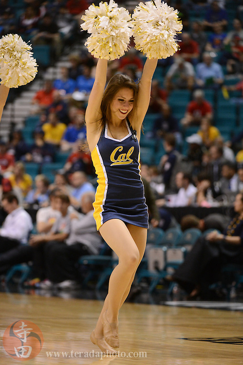 Mar 13, 2014; Las Vegas, NV, USA; California Golden Bears cheerleader performs during the first half against the Colorado Buffaloes in the quarterfinals of the Pac-12 Conference college basketball tournament at MGM Grand Garden Arena.