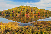 Reflection of autumn colors in northern lake<br />Goulais River<br />Ontario<br />Canada