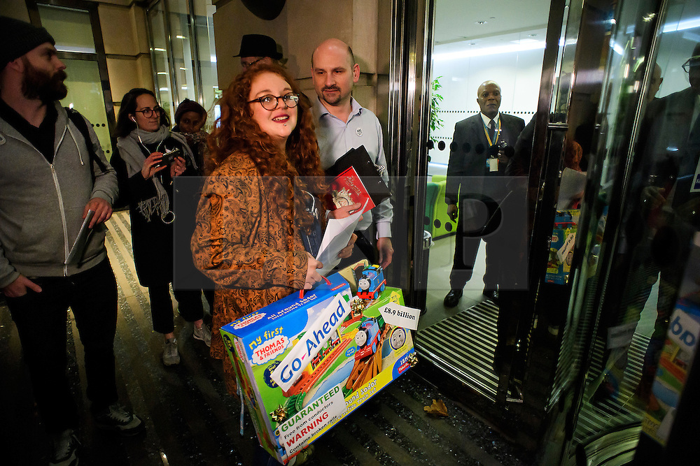 © Licensed to London News Pictures. 15/12/2016. London, UK. Commuters and campaigners deliver a letter and a toy train set to transport secretary Chris Grayling at the Department of Transport in London to protest  against ongoing bad service on Southern Rail trains and current industrial action. Negotiations between the rail operator and the train driver's union are due to resume today, in an attempt to prevent further strike action this week.  Photo credit: Ben Cawthra/LNP