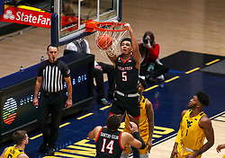 Jan 25, 2021; Morgantown, West Virginia, USA; Texas Tech Red Raiders guard Micah Peavy (5) dunks the ball during the second half against the West Virginia Mountaineers at WVU Coliseum. Mandatory Credit: Ben Queen-USA TODAY Sports