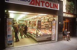 Interior of small supermarket in Barcelona viewed from street,