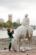 'The Rising Tide', art installation by Jason Decaires Taylor, between Vauxhall Bridge and the Houses of Parliament on the River Thames, London, UK. The sculptures of the four horses and riders, which were in place during the month for September 2015, are only revealed at low tide. © Rudolf Abraham