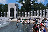 WASHINGTON - JUNE 30, 2019: Visitors cool off at the World War II Memorial fountain June 30, 2019, in Washington, D.C.