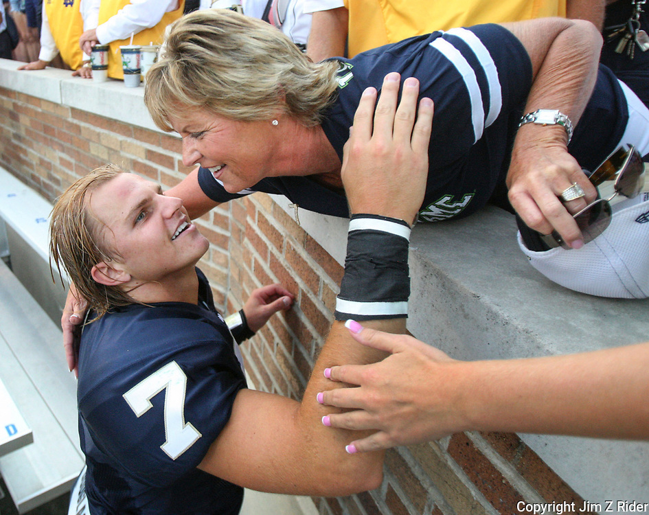 University of Notre Dame quarterback Jimmy Clausen, seen here in his sophomore year at Notre Dame Stadium embracing his mother, Cathy.