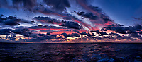 Colorful Dawn Panorama at Sea from the Aft Deck of the MV World Odyssey While Crossing the Pacific Ocean. Composite of 10 images taken with a  Fuji X-T1 camera and 23 mm f/1.4 lens (ISO 400, 23 mm, f/4, 1/60 sec). Raw images processed with Capture One Pro and AutoPano Giga Pro.