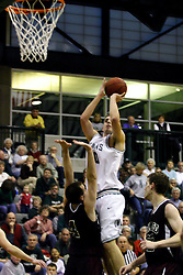 16 December 2006: Zach Freeman gets charged with an offensive foul while taking a shot. Brandon Woodhead is fouled. The University of Chicago Maroons upset  the Illinois Wesleyan Titans 64 - 60 at the Shirk Center in Bloomington Illinois.<br />