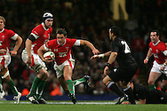Lee Byrne of Wales makes a break.Invesco Perpetual series 2008 autumn international match, Wales v New Zealand at the Millennium Stadium on Sat 22nd Nov 2008. pic by Andrew Orchard, Andrew Orchard sports photography,