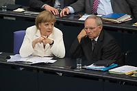 29 JUN 2012, BERLIN/GERMANY:<br /> Angela Merkel (L), CDU, Bundeskanzlerin, und Wolfgang Schaeuble (R), CDU, Bundesfinanzminister, im Gespraech, waehrend der Bundestagsdebatte zum Fiskalpakt, zum dauerhaften Euro-Rettungsschirm ESM, zur ESM-Finanzierung und zur Aenderung des Vertrags über die Arbeitsweise der Europaeischen Union , Plenum, Deutscher Bundestag<br /> IMAGE: 20120629-01-101<br /> KEYWORDS: Fiskalpakt, dauerhafter Rettungsschirm EFSM, Fiskalvertrag, Einrichtung des Europäischen Stabilitätsmechanismus, Europäischen Stabilitätsmechanismus ESM-Finanzierungsgesetz ESMF, Stabilitaetsunion, Wolfgang Schäuble