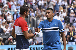 June 23, 2018 - London, England, United Kingdom - Marin Cilic of Croatia (L) reacts after victory to Nick Kyrgios of Australia (R) during their semi final match on day six of the Fever-Tree Championships at Queens Club on June 23, 2018 in London, United Kingdom. (Credit Image: © Alberto Pezzali/NurPhoto via ZUMA Press)
