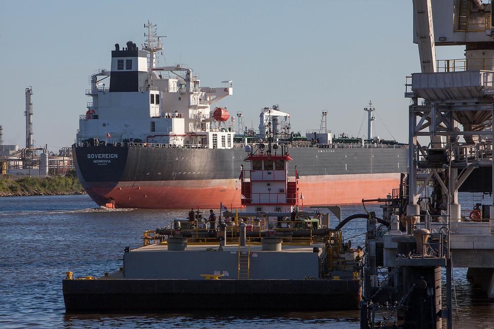 Oil Tanker passing platform in ship channel at Port of Houston