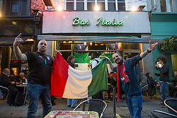 © Licensed to London News Pictures.  06/07/2021. London, UK. Italian football supporters pose to a picture between their match with Spain during the EURO 2020 in Bar Italia, Soho, central London. Photo credit: Marcin Nowak/LNP