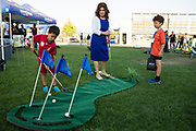 Mery Zelaya plays golf with her sons, Chris (left) and Sam, during the Silicon Valley Business Journal 40 Under 40 event at Avaya Stadium in San Jose, California, on July 31, 2018. (Stan Olszewski for Silicon Valley Business Journal)