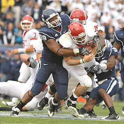 Oct 31, 2009; East Hartford, CT, USA; Connecticut defensive tackle Kendall Reyes (99) tackes Rutgers running back Joe Martinek (38) during second half Big East NCAA football action in Rutgers' 28-24 victory over Connecticut at Rentschler Field.