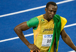 Usain Bolt of Jamaica after winning the gold medal in the men's 200 Metres Final during day six of the 12th IAAF World Athletics Championships at the Olympic Stadium on August 20, 2009 in Berlin, Germany. Bolt set a new World Record of 19.19 seconds. (Photo by Vid Ponikvar / Sportida)