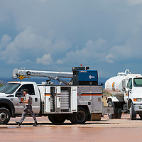 091913        Brian Leddy<br /> A worker walks around a truck at an Environmental Protection Agency site in Milan. The EPA is planning to temporarily move uranium tailings to the site.