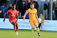 Scott Bennett of Newport county ® in action. EFL cup, 1st round match, Newport county v Milton Keynes Dons at Rodney Parade in Newport, South Wales on Tuesday 9th August 2016.<br /> pic by Andrew Orchard, Andrew Orchard sports photography.