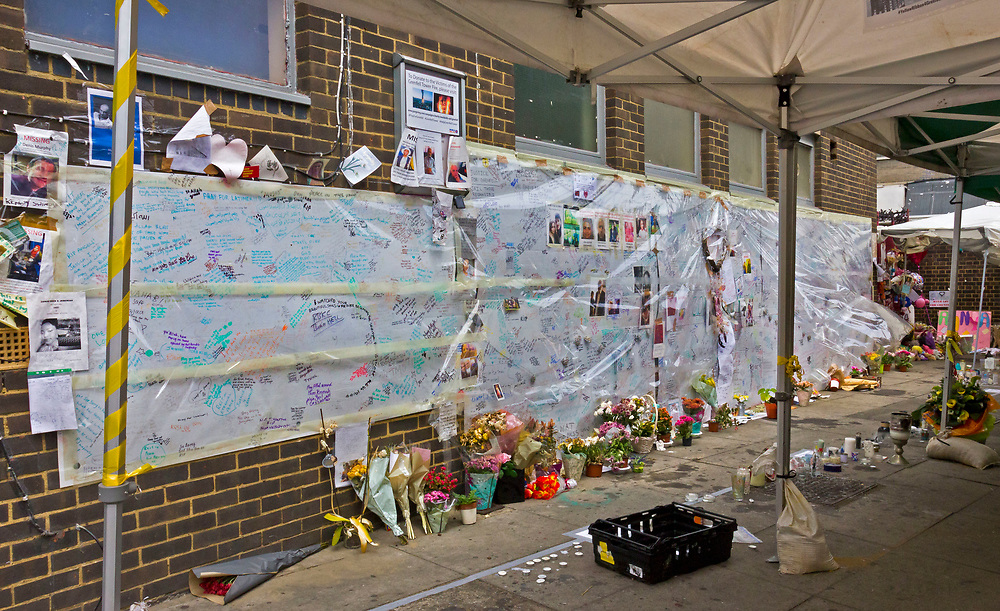9 July 2017 taken between the hours of 14.43 - 15.28<br /> <br /> Grenfell Tower's memorial wall of hope. Showing both the grief and anger of the community.<br /> <br /> The Grenfell Tower fire occurred on 14 June 2017 at the 24-storey, 220-foot-high (67 m), tower block of public housing flats in North Kensington, Royal Borough of Kensington and Chelsea, West London. It caused at least 80 deaths and over 70 injuries. A definitive death toll is not expected until at least 2018. As of 5 July 2017, 21 victims had been formally identified by the Metropolitan Police. Authorities were unable to trace any surviving occupants of 23 of the flats. (Source Wikipedia}