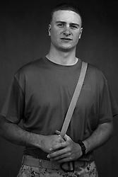 Lcpl. Brandon Bury, 22, Houston, Texas, Weapons Platoon, Kilo Co., 3rd Battalion 1st Marines, United States Marine Corps, at the company's firm base in Haditha, Iraq on Sunday Oct. 22, 2005.