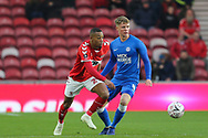Middlesbrough midfielder Rajiv Van La Parra (29) chases after the ball as Peterborough United midfielder Mark O'Hara (8) watches on during The FA Cup 3rd round match between Middlesbrough and Peterborough United at the Riverside Stadium, Middlesbrough, England on 5 January 2019.