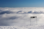 Sign indicating the direction to diamond run Snow Bird, near the top of ski field Turoa. Turoa is located on active volcano Mount Ruapehu, New Zealand.