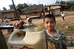After school La usually has some tasks to do, collecting water is an easy one as the standpipe is just 20 meters from his village home. , Vang Mak primary school, Vieng thong district, Bolikhamxai Province, Lao PDR