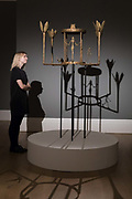 A member of staff looks at Lustre avec femme, homme et iseau 1952 by Alberto Giacometti Picasso on February 22nd, 2018 at the preview for Sothebys upcoming Impressionist, Modern and Surrealist Art auction at Sothebys in New Bond Street, London, England.