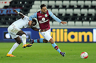 Aston Villa's Joleon Lescott (r) brings down Swansea's Bafetimbi Gomis. Barclays Premier league match, Swansea city v Aston Villa at the Liberty Stadium in Swansea, South Wales on Saturday 19th March 2016.<br /> pic by  Carl Robertson, Andrew Orchard sports photography.