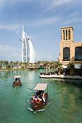 Madinat Jumeirah Resort. Mina A'Salam Hotel. Burj Al Arab (l.), electric abras (water texis).