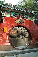 A-Ma Temple is said to be the place in Macau where the Portuguese first landed.  The Temple consists of prayer halls, pavilions and courtyards built into the boulder strewn hill connected by winding paths through moon gates and tiny gardens. At the entrance is a large rock on which a traditional sailing junk was etched over 400 years ago. On other boulders you can see red carved characters invoking the blessings of the gods. Chinese say that touching the top of the moon gate up the hill will bring good luck in love.