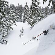 Tyler Hatcher finds super deep snow in the backcountry near Mount Baker Ski Area.