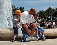 ATP TENNIS CHAMPIONSHIPS KEY BISCAYNE MIAMI 30/03/03<br />ANDRE AGASSI (USA) WITH TROPHY AFTER HE WINS MENS FINAL BUT ONE OF HIS ADMIRERS WAS A LITTLE CAMERA SHY<br />PHOTO ROGER PARKER  FOTOSPORTS INTERNATIONAL