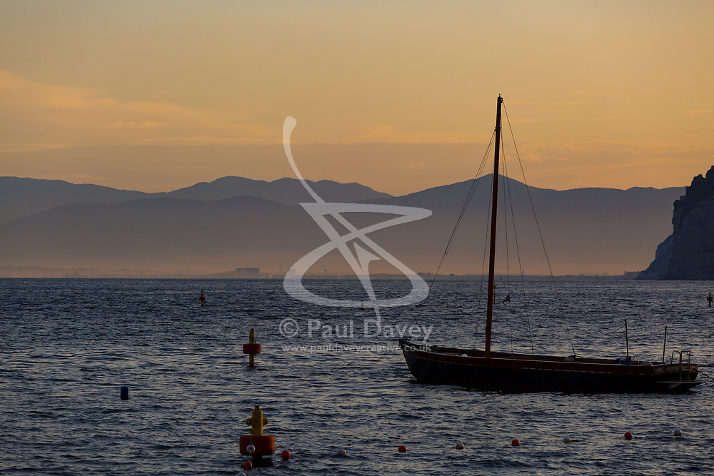 Sorrento, Italy, September 16 2017. A boat lies at anchor as day breaks in Marina Grande, Sorrento, Italy. © Paul Davey