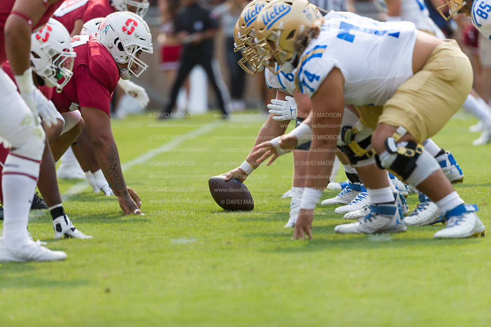 PALO ALTO, CA - SEPTEMBER 26:  The Stanford Cardinal and the UCLA Bruins face off at the line of scrimmage during an NCAA Pac-12 college football game on September 26, 2021 at Stanford Stadium in Palo Alto, California.  (Photo by David Madison/Getty Images)