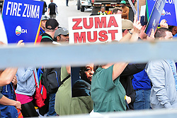 JOHANNESBURG, SOUTH AFRICA – APRIL 07: DA (Democratic Alliance) supporters march in protest as part of a nationwide call for President Zuma to step down, in Johannesburg, South Africa, 07 April 2017. Businesses closed and South Africans from numerous political, religious, labour and civic groups gathered at central points across the entire country protesting against President Zuma's recent government reshuffle appointing 10 new ministers and 10 new deputy ministers including the axing of the finance minister. Photo: Dino Lloyd
