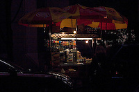 Hotdog stand after dark Midtown Manhattan New York