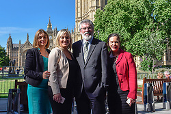 © Licensed to London News Pictures. 15/06/2017. London, UK. (L to R) Elisha McCallion, Michelle O'Neill, leader of Sinn Féin, Gerry Adams, President, and Mary Lou McDonald outside Westminster.  Members of the Northern Ireland Assembly visit Downing Street met for talks with Prime Minister Theresa May following the results of the General Election.  The Conservatives are seeking to work with the Democratic Unionist Party in order to form a minority government. Photo credit : Stephen Chung/LNP
