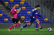 AFC Wimbledon attacker Ryan Longman (29) dribbling away from Peterborough United midfielder Louis Reed (14) during the EFL Sky Bet League 1 match between AFC Wimbledon and Peterborough United at Plough Lane, London, United Kingdom on 2 December 2020.