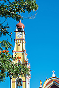 The San Jeromino Parish church bell tower and clock in the central historic district of Coatepec, Veracruz State, Mexico.