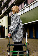 Elderly woman in front of her appartment, with her trolly. At her age she can only walk with support of this vehicle. ©Reporters/sanderdewilde